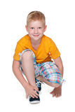 Smiling little boy in a yellow shirt Royalty Free Stock Photos