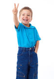 Smiling little boyl with victory sign Stock Image