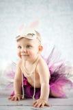 Smiling little bunny. Cute baby girl with bunny ears - studio shot Stock Image