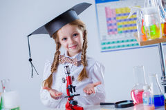 Smiling little chemist posing with microscope Royalty Free Stock Photos