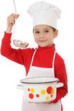 Smiling little chief-cooker with ladle and pot Stock Images