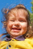 Smiling little child against the sky Stock Image