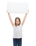 Smiling little child holding blank white board Royalty Free Stock Photography