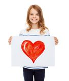 Smiling little child holding picture of heart Royalty Free Stock Images
