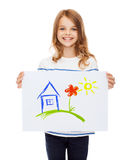 Smiling little child holding picture of house Stock Photo