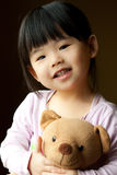 Smiling little child with a teddy bear Stock Image