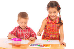 Smiling little children with watercolor paintings Royalty Free Stock Images