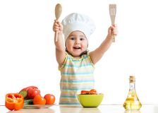 Smiling little cook with ladle, isolated on white Royalty Free Stock Photo