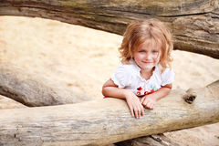 Smiling little girl. Little blond girl with blue eyes smiling Stock Images