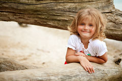 Smiling little girl. Girl with blue eyes smiling and looking straight to the camera royalty free stock images