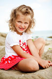 Smiling little girl. Girl with blue eyessmiling and lookingstraight to the camera royalty free stock photography
