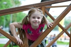Smiling little girl. In a wooden structures Stock Photo