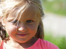 Smiling little girl Stock Images
