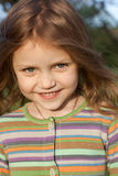 Smiling little girl. Portrait of a beautiful child smiling Stock Photo