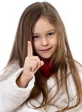 Smiling little girl. Shows the finger Royalty Free Stock Photography