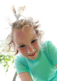 Smiling little girl. Portrait of bended smiling little girl in blue t-shirt Stock Images