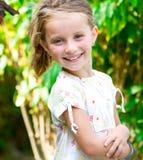 Smiling little girl Stock Images