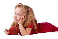 Smiling little girl. With a toy in the hands Royalty Free Stock Photo