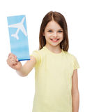 Smiling little girl with airplane ticket Stock Photography