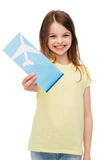 Smiling little girl with airplane ticket Stock Photo