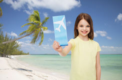 Smiling little girl with airplane ticket Royalty Free Stock Photos