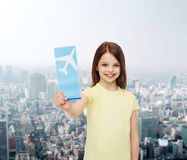 Smiling little girl with airplane ticket Stock Images