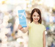 Smiling little girl with airplane ticket Royalty Free Stock Photo