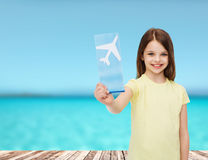 Smiling little girl with airplane ticket Stock Image