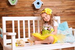 Smiling little girl and alive chickens on bench Stock Images