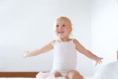 Smiling little girl with arms raised Royalty Free Stock Images