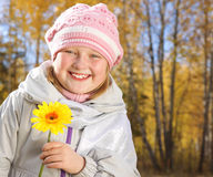 Smiling little girl in the autumn forest. royalty free stock photography