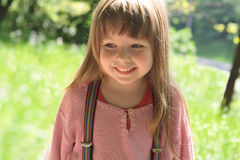Smiling little girl background of nature Royalty Free Stock Images