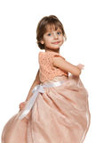 Smiling little girl in a ball gown Stock Images