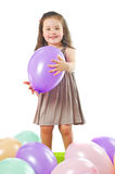 Smiling little girl with balloon Stock Image