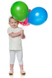 Smiling little girl with balloons Stock Photo