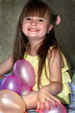 Smiling Little Girl with Balloons Royalty Free Stock Photos