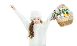 Smiling little girl with basket full of colorful easter eggs Royalty Free Stock Photos