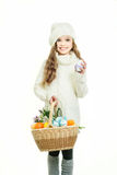 Smiling little girl with basket full of colorful easter eggs Stock Image