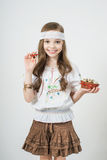 Smiling little girl with basket full of colorful easter eggs Royalty Free Stock Photography