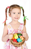 Smiling little girl with basket full of colorful easter eggs iso Royalty Free Stock Image