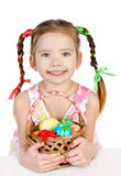 Smiling little girl with basket full of colorful easter eggs iso Stock Image