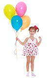 Smiling little girl with beads in their hands Royalty Free Stock Photography