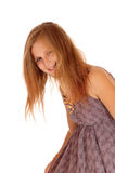 Smiling little girl bending down. Royalty Free Stock Photography