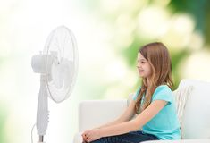 Smiling little girl with big fan at home Stock Photography