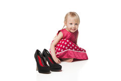 Smiling little girl with big shoes Royalty Free Stock Images