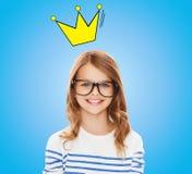 Smiling little girl with black eyeglasses Stock Image