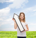 Smiling little girl with blank arrow pointing up Stock Photography
