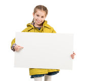 Smiling little girl with blank sheet in hands Royalty Free Stock Images