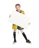 Smiling little girl with blank sheet in hands Stock Photography