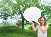 Smiling little girl with blank text bubble Stock Images